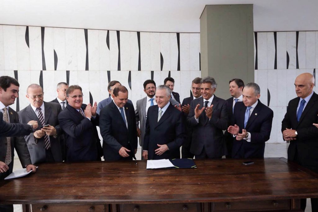 Politicians applaud after Brazil's Vice President Michel Temer (C) signed a document notifying him of becoming the interim president after the Brazilian Senate voted to impeach President Dilma Rousseff. (Marcos Correa/Courtesy of Brazil's Vice Presidency/Handout via Reuters)