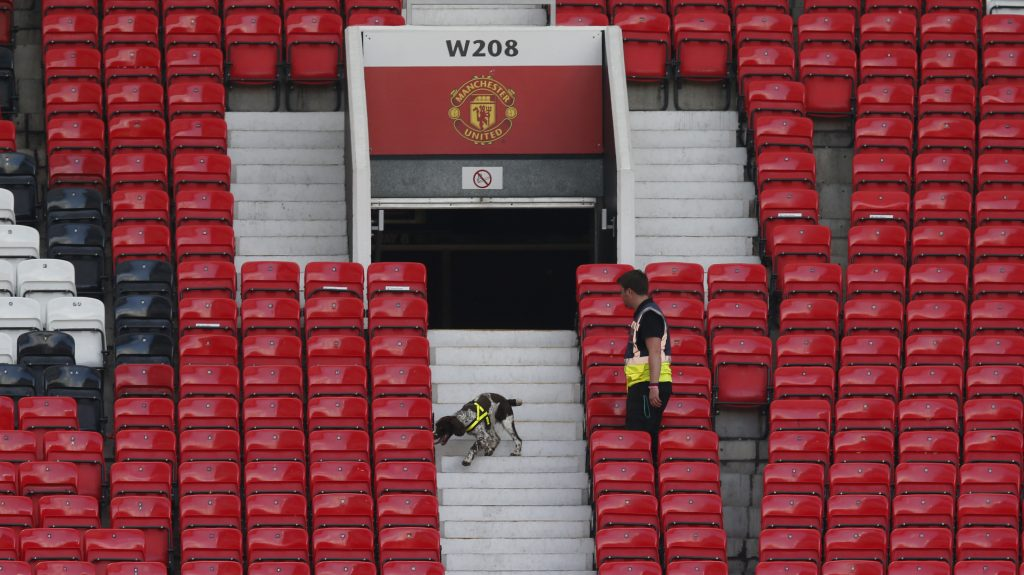 A police dog is led through the stadium after its evacuation. (Reuters/Andrew Yates Livepic)