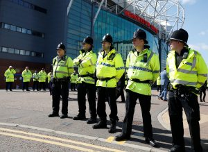 Police outside the stadium after it was evacuated. (Reuters / Andrew Yates/Livepic)