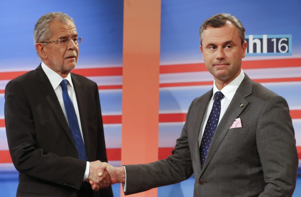 Presidential candidates Norbert Hofer (R) and Alexander Van der Bellen shake hands before a debate in Vienna on Sunday. (Reuters/Heinz-Peter Bader)