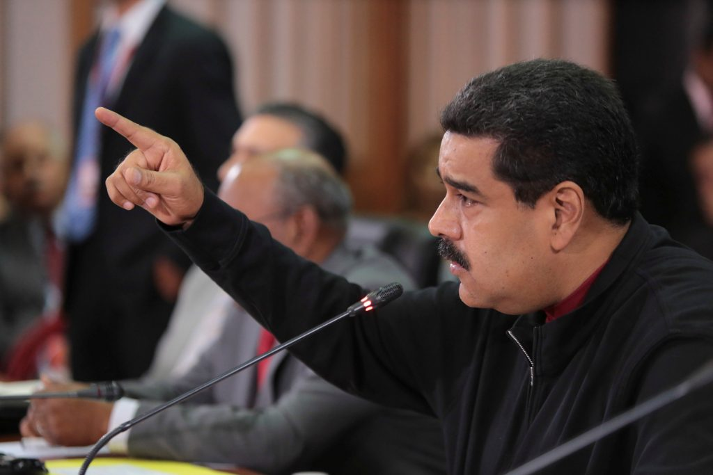 Venezuela's President Nicolas Maduro speaks during the 16th PetroCaribe Ministerial Council in Caracas. (Miraflores Palace/Handout/Reuters)