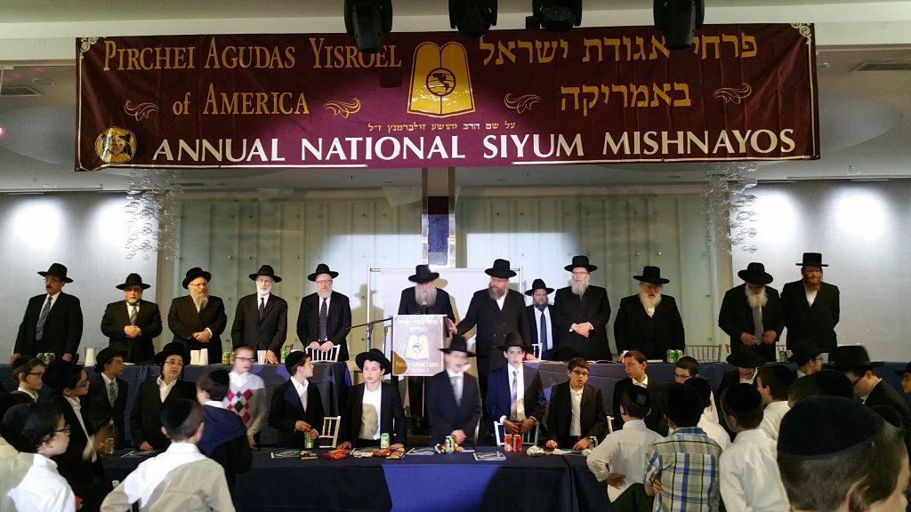 Rabbi Yehoshua Grunfeld, Rosh Kollel of Iyun Hatalmud in Monsey, leading the recital of Tehillim. (Hillel Engel/Agudas Yisroel of America)