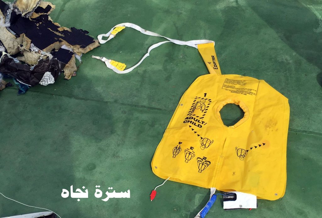 """Recovered debris of the EgyptAir jet that crashed in the Mediterranean Sea is seen with the Arabic caption """"life jacket"""" in this handout image released May 21, 2016 by Egypt's military. Egyptian Military/Handout via Reuters ATTENTION EDITORS - THIS IMAGE WAS PROVIDED BY A THIRD PARTY. EDITORIAL USE ONLY. NO RESALES. NO ARCHIVE."""