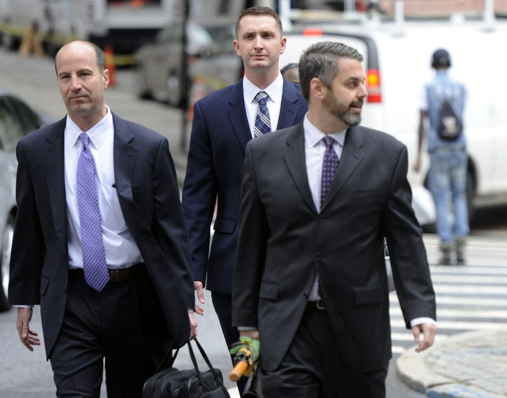 From left, attorney Marc Zayon, Baltimore Police Officer Edward Nero, and attorney Jason Silverstein, walk to the courthouse before hearing on Tuesday in Baltimore. (Kim Hairston/The Baltimore Sun via AP)