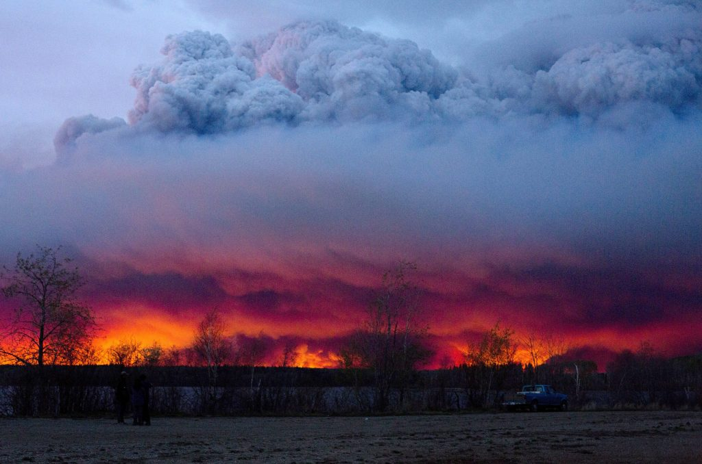 A wildfire moves towards the town of Anzac from Fort McMurray, Alberta, on Wednesday. (Jason Franson/The Canadian Press via AP)