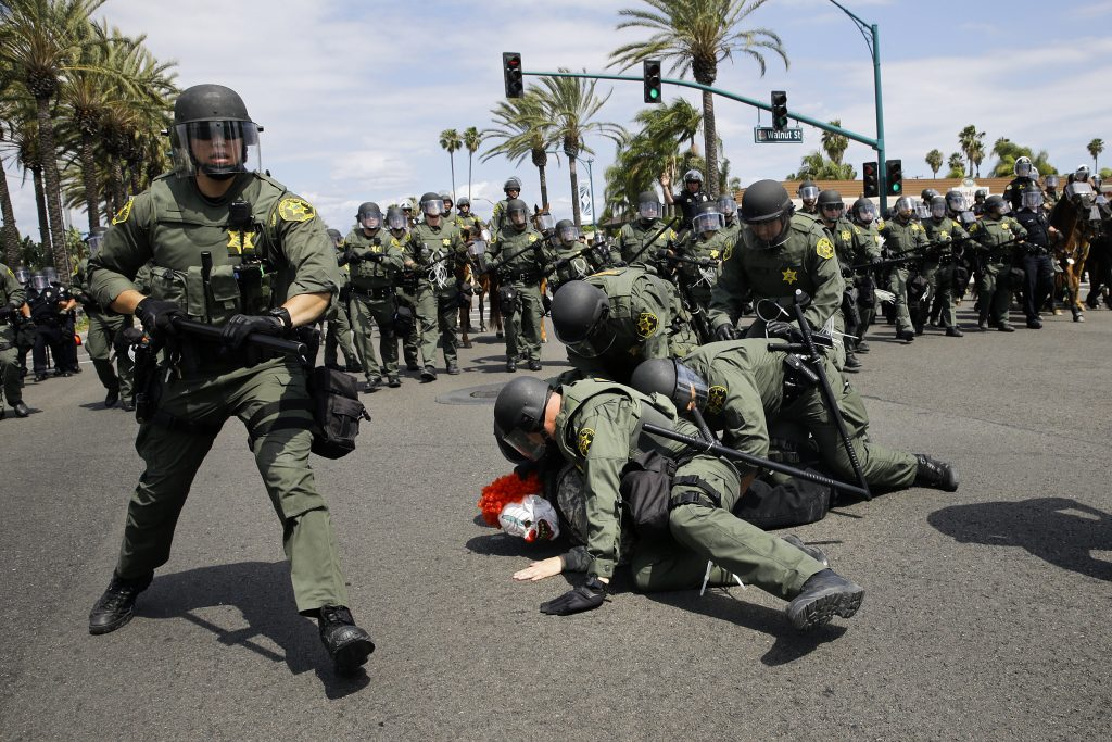 Orange County Sheriff's deputies take a protester into custody near the Anaheim Convention Center Wednesday, May 25, 2016, in Anaheim, Calif. Republican presidential candidate Donald Trump held a rally at the convention center. (AP Photo/Jae C. Hong)