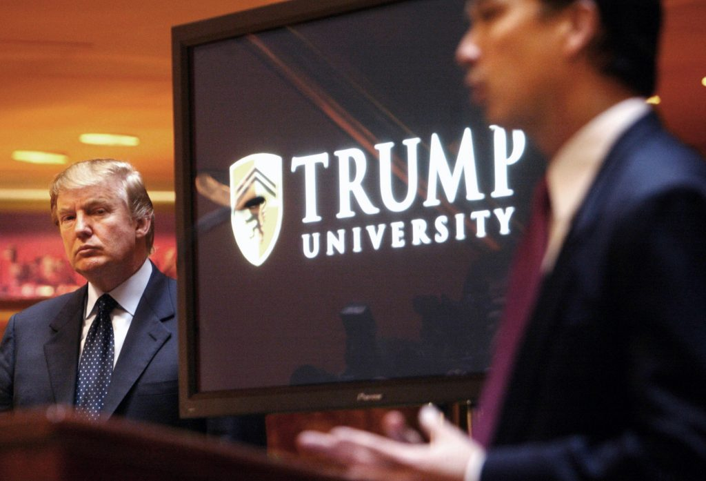 In this May 23, 2005 photo, Donald Trump, left, listens as Michael Sexton introduces him at a news conference in New York, where he announced the establishment of Trump University. (AP Photo/Bebeto Matthews, File)