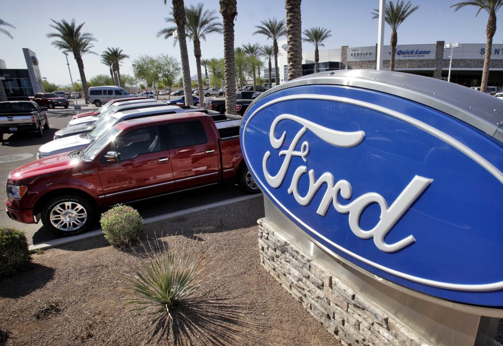 FILE - In this March 29, 2011, file photo, new 2011 Ford F-150 trucks are shown at a dealership in Glbert, Ariz. (AP Photo/Matt York, File)