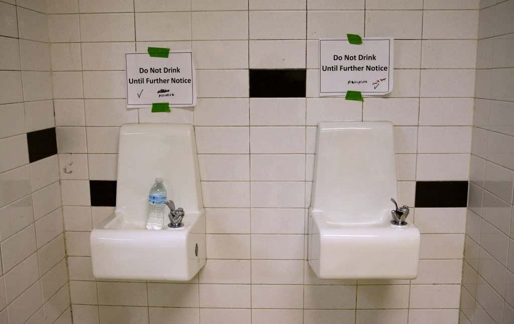"""In this May 4 photo, drinking fountains are marked """"Do Not Drink Until Further Notice"""" at Flint Northwestern High School in Flint, Mich. (AP Photo/Carolyn Kaster File)"""