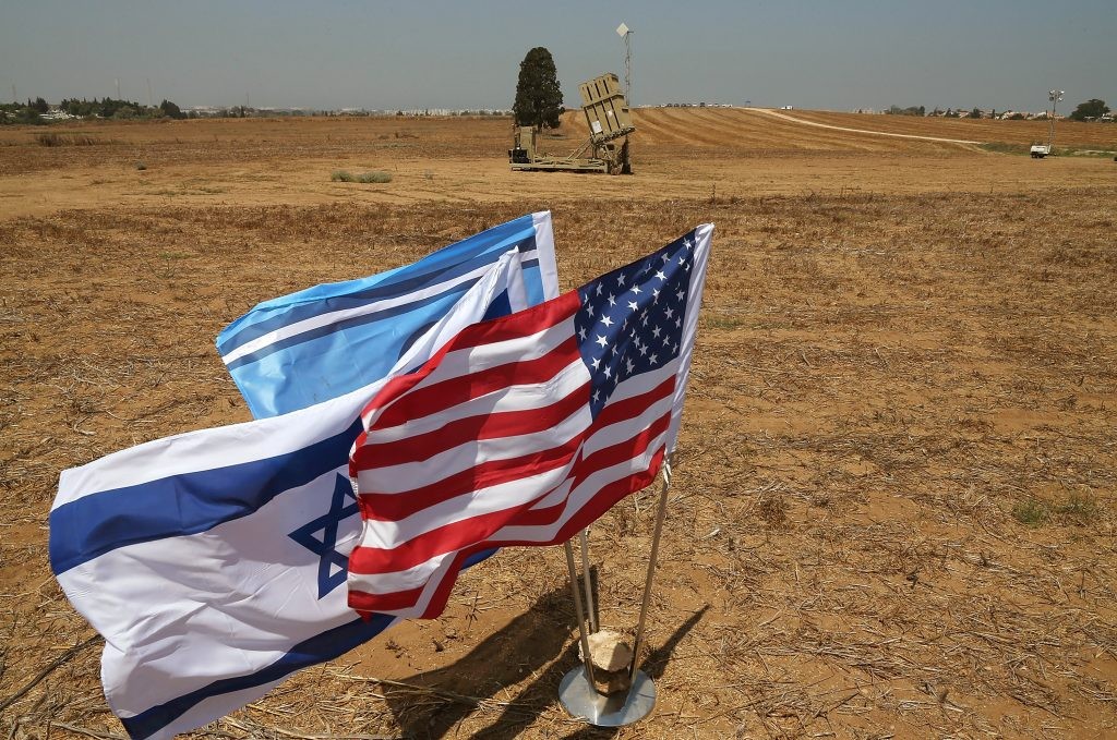 The flags of the U.S., Israel and the Israeli air Force are positioned near a missile launcher in Ashkelon, Israel, in this Aug. 1, 2012 photo, as then- Israeli Defense Minister Ehud Barak and Defense Secretary Leon Panetta participated in a joint news conference during their visit to the Iron Dome defense system launch site. (AP Photo/Mark Wilson, Pool)