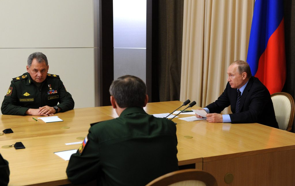 Russian Defense Minister Sergei Shoigu, left, and President Vladimir Putin, right, at a meeting with officials in the Bocharov Ruchei residence in Sochi, Russia, on May 10. (Mikhail Klimentyev, Sputnik, Kremlin Pool Photo via AP)