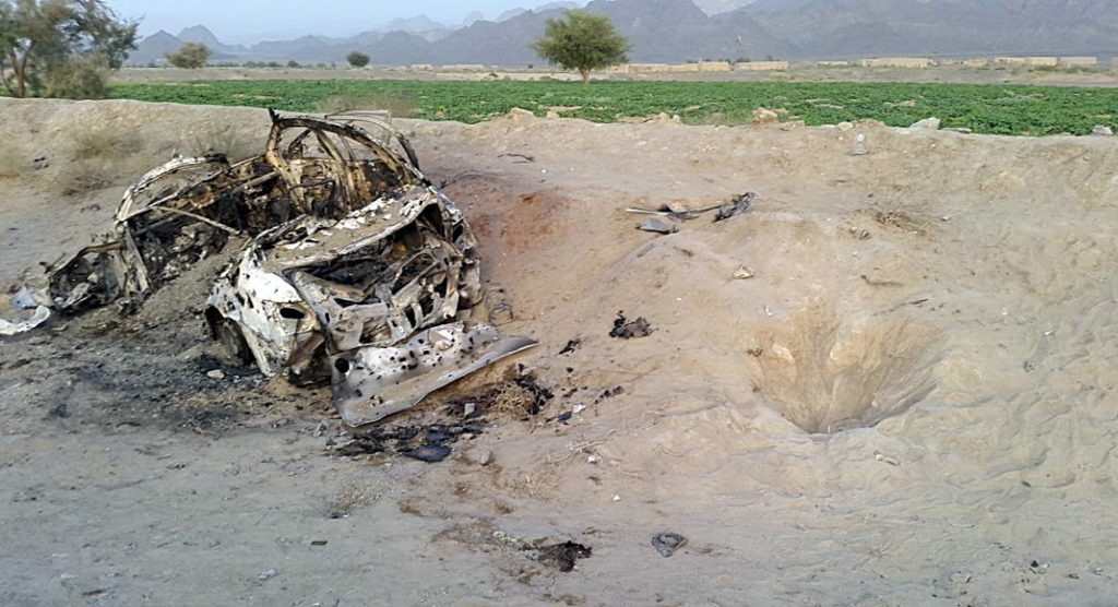 This photo taken by a freelance photographer Abdul Salam Khan using his smart phone on Sunday, May 22, 2016, purports to show the destroyed vehicle in which Mullah Mohammad Akhtar Mansour was traveling in the Ahmad Wal area in Baluchistan province of Pakistan, near Afghanistan's border. A senior commander of the Afghan Taliban confirmed on Sunday that the extremist group's leader, Mullah Mohammad Akhtar Mansour, has been killed in a U.S. drone strike. (AP Photo/Abdul Salam Khan)