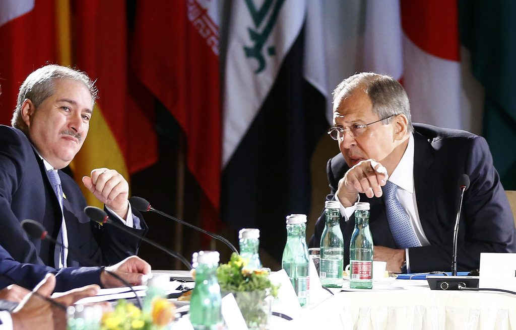 Russian Foreign Minister Sergei Lavrov, right, and Jordanian Foreign Minister Nasser Judeh, left, attend the ministerial meeting on Syria in Vienna, Austria, Tuesday, May 17, 2016. (Leonhard Foeger/Pool Photo via AP)
