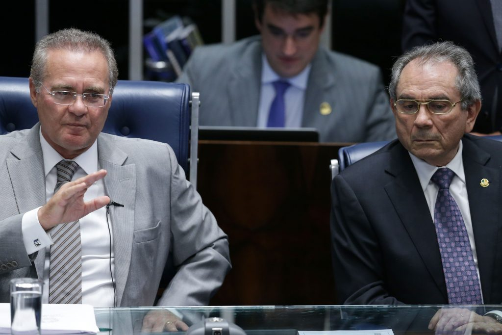 President of the Brazilian Senate Senator Renan Calheiros, left, sits next to the President of the Impeachment Commission, Senator Raimundo Lira, during the session on the impeachment process against Brazil's President Dilma Rousseff, at the Federal Senate, in Brasilia, Brazil, on Monday. (AP Photo/Eraldo Peres)