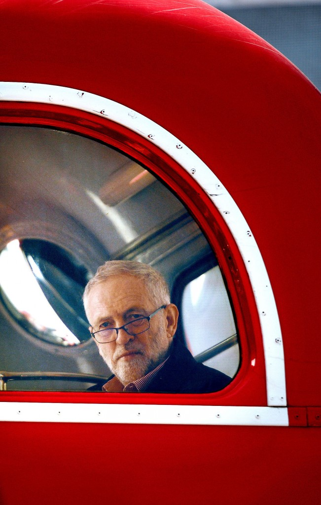 Britain's Labour Party leader Jeremy Corbyn sits aboard a London bus as he waits to address the crowd at a May Day rally in central London, Sunday. (Anthony Devlin/PA via AP)