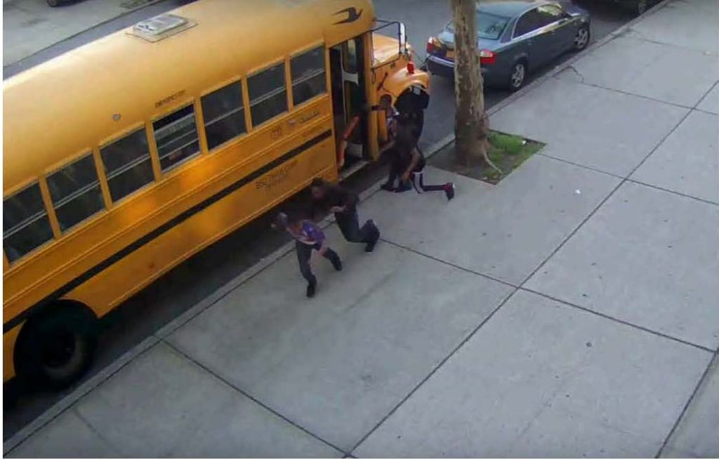 Video shows youths at the bus door and fleeing the scene; one of them was arrested on Monday.(Jewish Leadership Council)