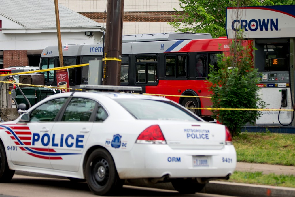 Police work at the crime scene after the bus hijacking on Tuesday in Washington. (AP Photo/Andrew Harnik)