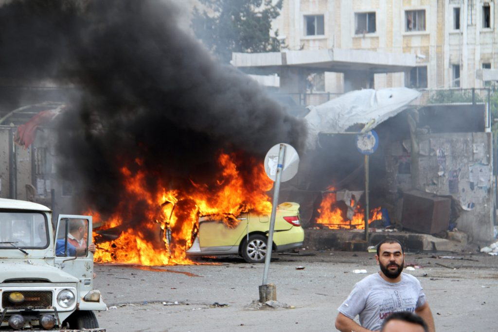 People inspect the damage after explosions hit the Syrian city of Tartous, in this handout picture provided by SANA on May 23, 2016. SANA/Handout via REUTERS ATTENTION EDITORS - THIS IMAGE WAS PROVIDED BY A THIRD PARTY. REUTERS IS UNABLE TO INDEPENDENTLY VERIFY THIS IMAGE. EDITORIAL USE ONLY.
