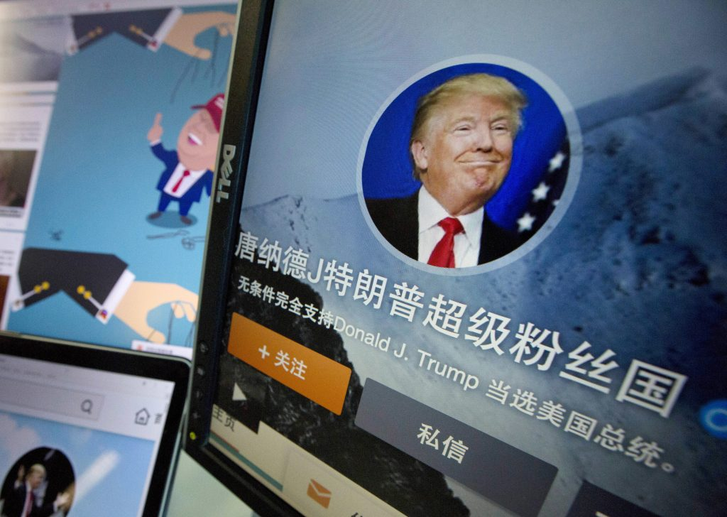"""In this May 18, 2016 photo, Chinese fan websites for Donald Trump are displayed on a computer with the words """"Donald J. Trump super fan nation, Full and unconditional support for Donald J. Trump to be elected U.S. president"""" in Beijing, China. China features prominently in the rhetoric of presumed Republican presidential candidate Donald Trump, who accuses the country of stealing American jobs and cheating at global trade. In China itself, though, he's only now emerging as a public figure, despite a notoriety elsewhere for his voluble utterances, high-profile businesses and reality TV show. (AP Photo/Ng Han Guan)"""