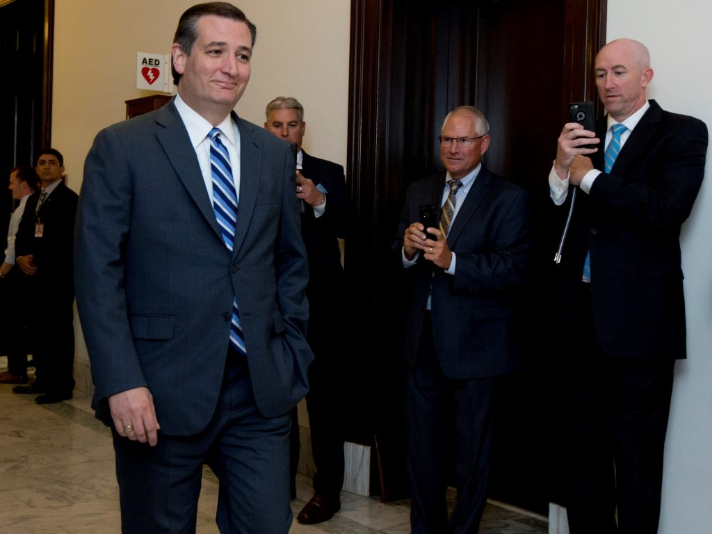 Former Republican presidential, candidate Sen. Ted Cruz, R-Texas, walks past reporters as he returns to Capitol Hill on Tuesday. (AP Photo/Manuel Balce Ceneta)