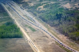 Traffic at a standstill on Highway 63 heading south, as residents flee with wildfires burning in and around Fort McMurray, Alberta, on Wednesday. (Jeff McIntosh/The Canadian Press via AP)