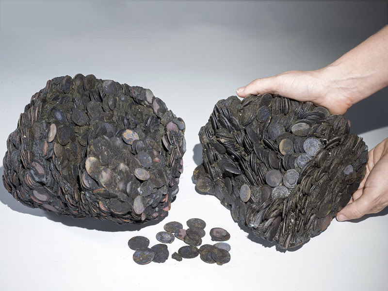 Lumps of coins that were discovered at sea, weighing a total of 44 pounds. (Clara Amit, courtesy of the Israel Antiquities Authority)