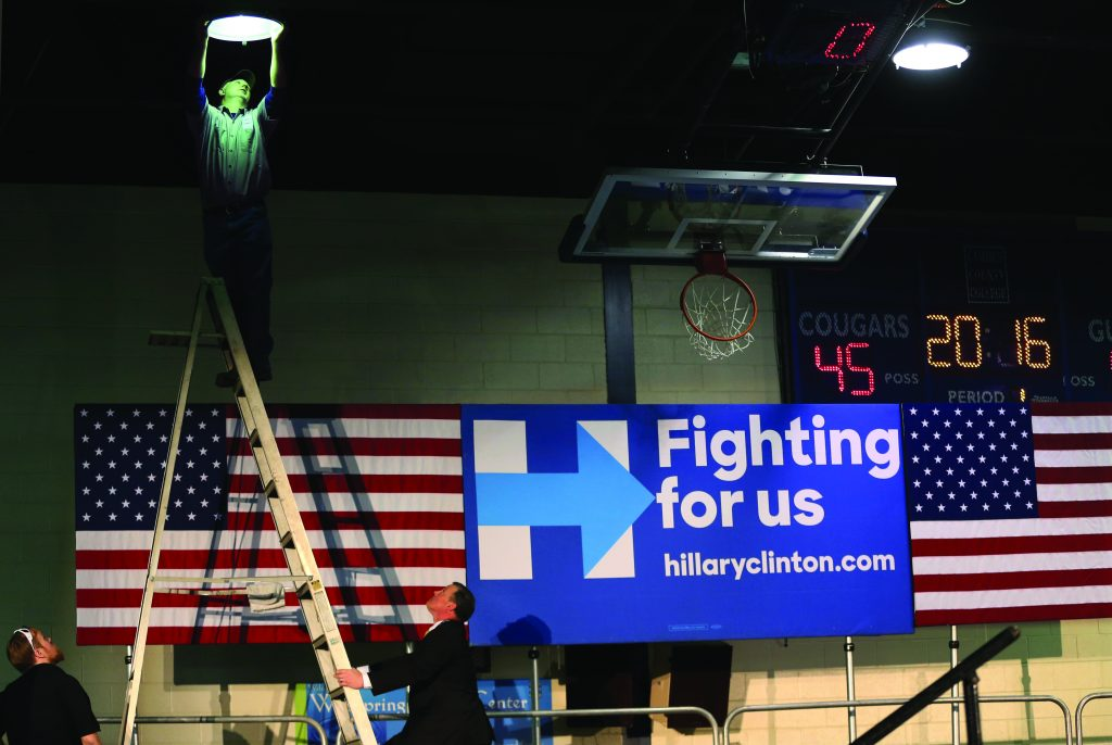 Workers prepare a stage for Democratic presidential candidate Hillary Clinton, who held a campaign rally Wednesday in Blackwood, N.J. (AP Photo/Mel Evans)