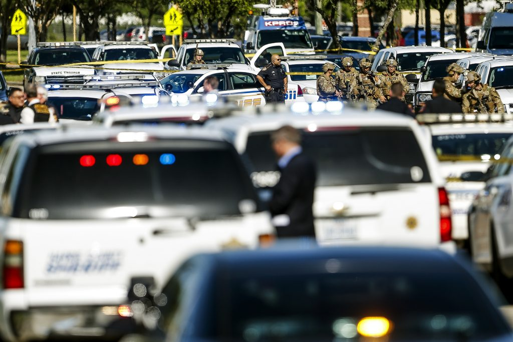 Sheriff's deputies surround Knight Transportation in Katy, Texas, after the fatal shootings Wednesday. (Michael Ciaglo/Houston Chronicle via AP)