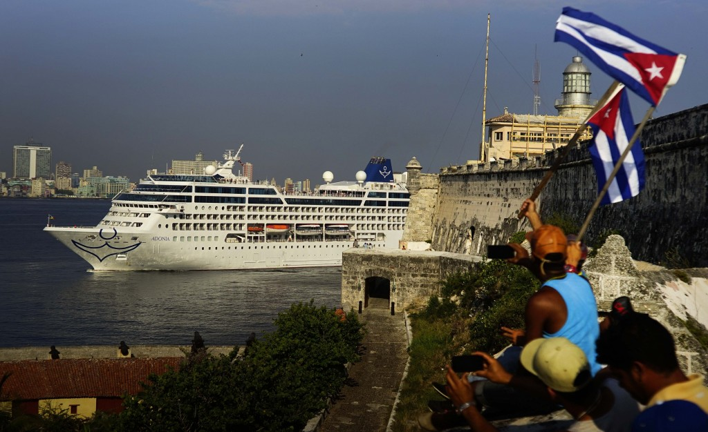 People waving Cuban flags on Monday greet passengers on Carnival's Adonia cruise ship as they arrive from Miami in Havana. (AP Photo/Ramon Espinosa)