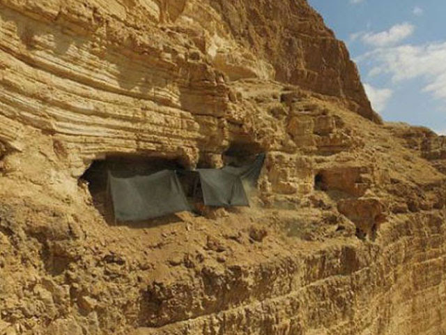 The cave where the archaeological excavation is being conducted is situated 80 meters from the top of the cliff and 250 meters above the base of the wadi. (Guy Fitoussi, courtesy of the IAA.)