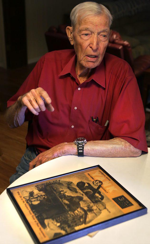 William Phelps, with a copy of the Yank magazine thatmade him famous. (Bob Owen/The San Antonio Express-News via AP)
