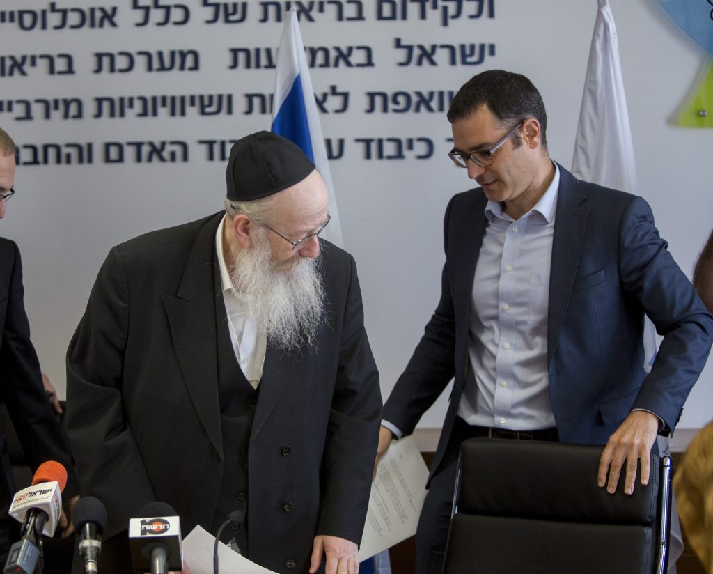 "Outgoing Director General of the Ministry of Health, Prof. Arnon Afek (L) seen with Deputy Health Minister Yaakov Litzman (C) and Incoming Director General of the Ministry of Health Moshe Bar Siman Tov during a press conference regarding new mental health reform at the Ministry of Health office in Jerusalem on June 8, 2015. Photo by Yonatan Sindel/Flash90 *** Local Caption *** בריאות הנפש ארנון אפק מנכ""ל משרד הבריאות משרד הבריאות יעקב ליצמן משה בר סימן טוב"