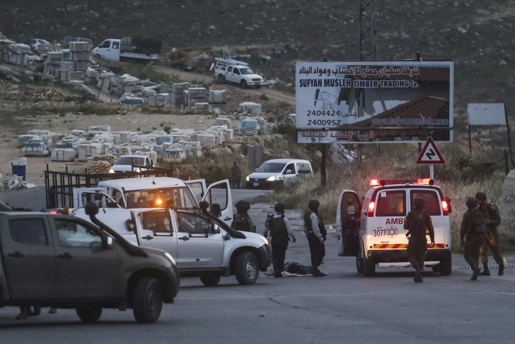 Israeli security forces at the scene of the attack in Dolev. (Flash90)