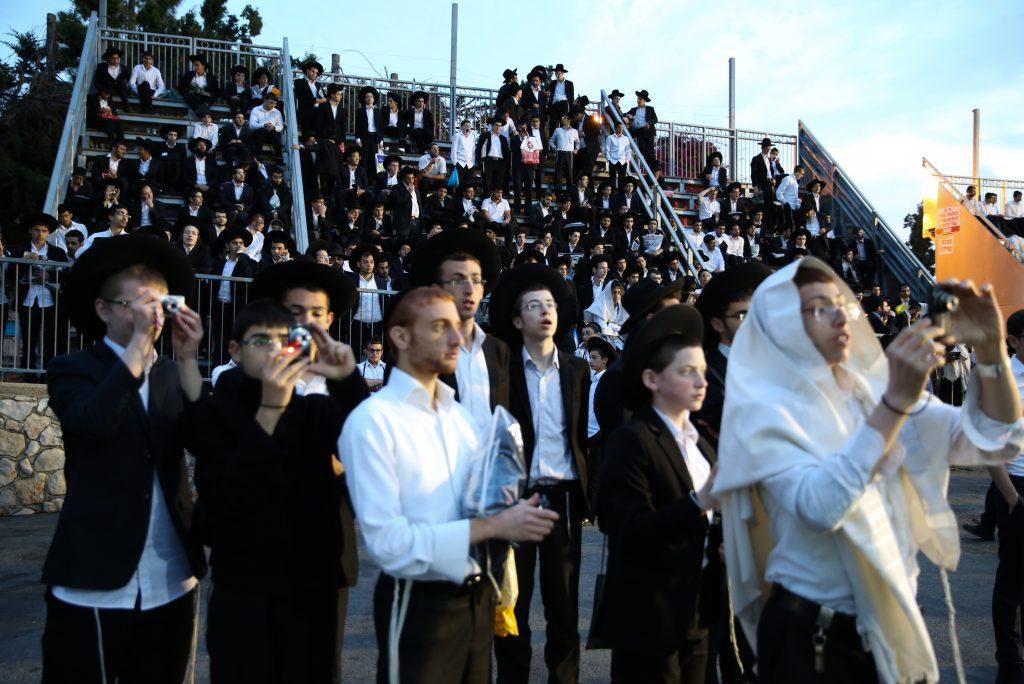 Followers of Rabbi Shalom Cohen during Shachrit at the Kever of Reb Shimon Bar Yochai in Mount Meron, Northern Israel, May 4, 2016. (Yaacov Cohen/Flash90)