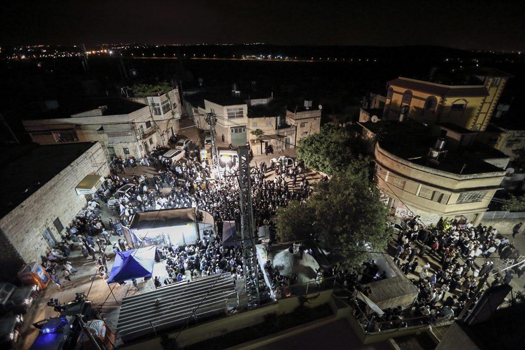 Thousands of Ultra Orthodox Jewish men entered the Palestinian village of Kif al Harat, in the West Bank, accompanied by Israeli soldiers, to pray at the tombs of Yehoshua Ben Nun and Kaleb Ben Yepune, on May 3, 2016. Photo by yaakov Naumi/Flash90. *** Local Caption *** ëðéñä ùì àìôé éäåãéí çøãéí áìéååé öáàé ìëôø äòøáé ëéó àì çøàú' ìéã àøéàì ìúôéìä á÷áøé öãé÷éí - éäåùò áï ðåï, àáéå ðåï, åëìá áï éôåðä çééìéí