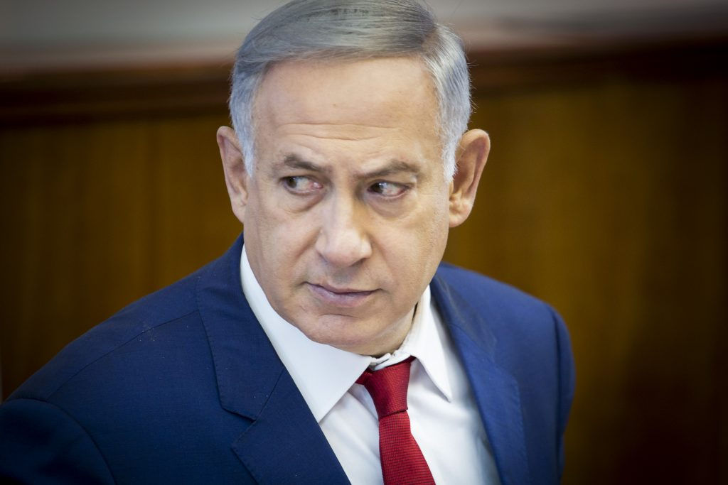 Israeli Prime Minister Binyamin Netanyahu, shown here leading the weekly cabinet meeting at the Prime Minister's office in Yerushalayim on Sunday. (Emil Salman/POOL)