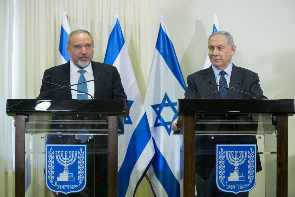 Israeli Prime Minister Binyamin Netanyahu (R) and Yisrael Beyteinu leader Avigdor Liberman. (Yonatan Sindel/Flash90)