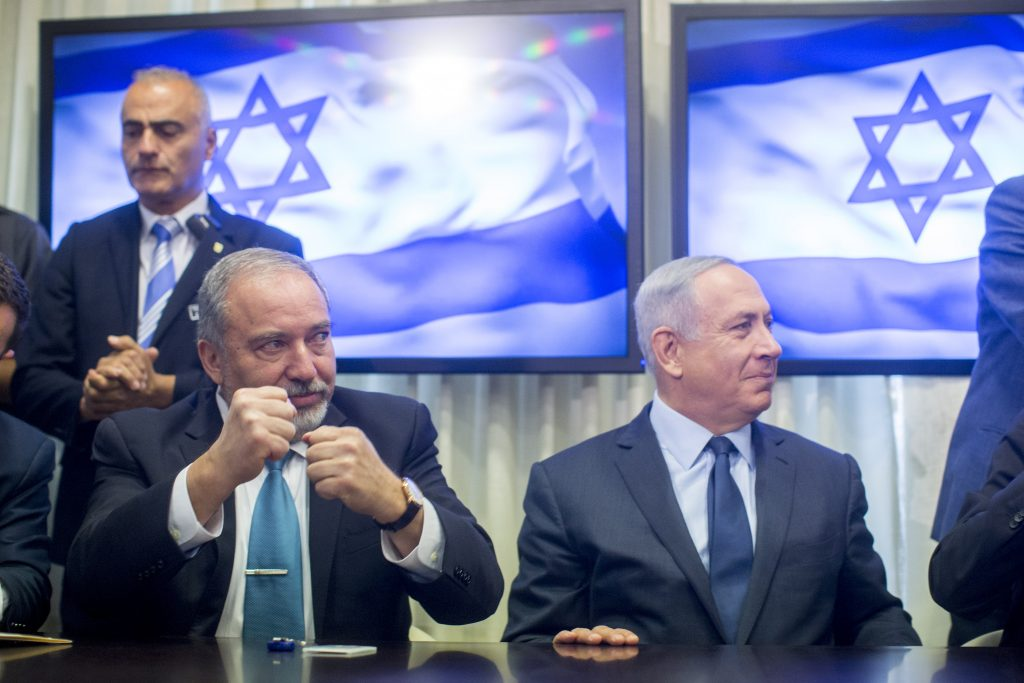PM Binyamin Netanyahu and leader of the Israel Beyteinu Avigdor Liberman sign an agreement in the Knesset which will bring Israel Beyteinu into the coalition and name him defense minister. (Yonatan Sindel/Flash90)