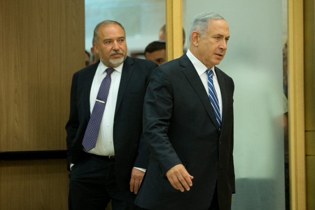 Prime Minister Binyamin Netanyahu and new Defense Minister Avigdor Lieberman entering the room for a joint press conference at the Knesset on Monday. (Yonatan Sindel/Flash90)