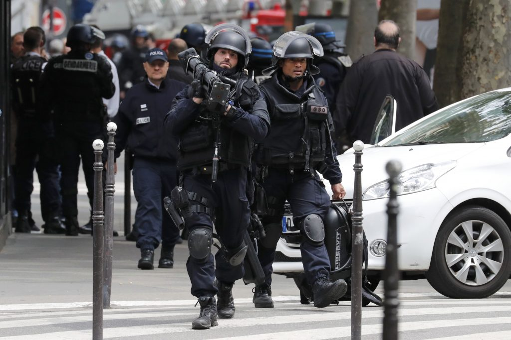 Special intervention French gendarmes and police leave the scene after an operation in Paris, France, May 26, 2016. REUTERS/Benoit Tessier