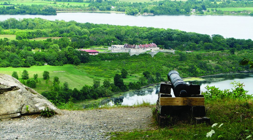An ancient cannon rests on a hill overlooking Fort Ticonderoga. (Flickr)