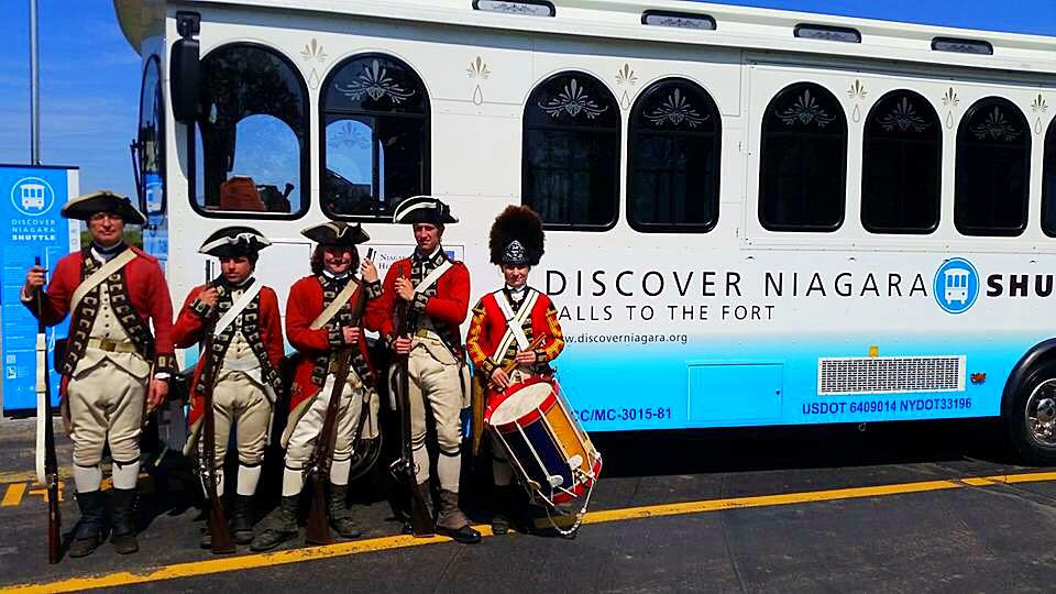 Residents dressed as 18th-century British redcoats on Friday mark the opening of the Discover Niagara shuttle in Niagara Falls, NY. (Discover Niagara)
