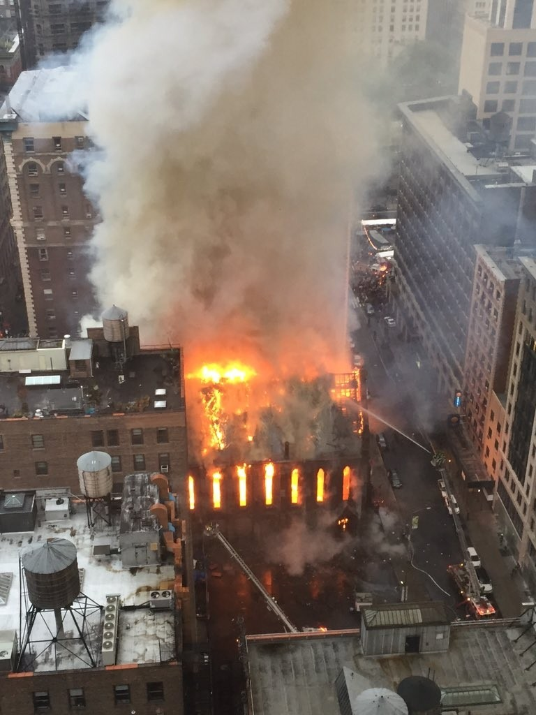 Firefighters on Sunday battle flames at a historic church in Manhattan. (Anindya Ghose via AP)