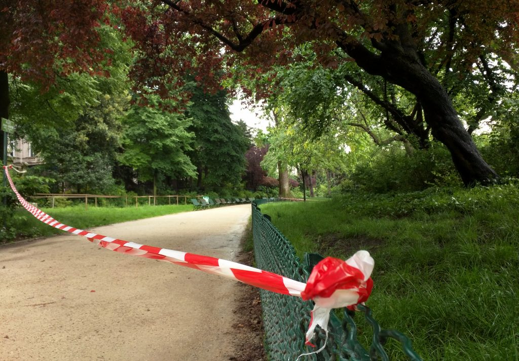White-and-red tape is strung across a sandy pathway through Park Monceau after a lightning stike, in Paris, Saturday, May 28, 2016. A Paris fire service spokesman says 11 people including eight children have been hit by lightning in a Paris park after a sudden spring storm overtook a child's birthday party. The victims had sought shelter Saturday under a tree at Park Monceau, a popular weekend hangout for well-to-do families in Paris. (AP Photo/Raphael Satter)