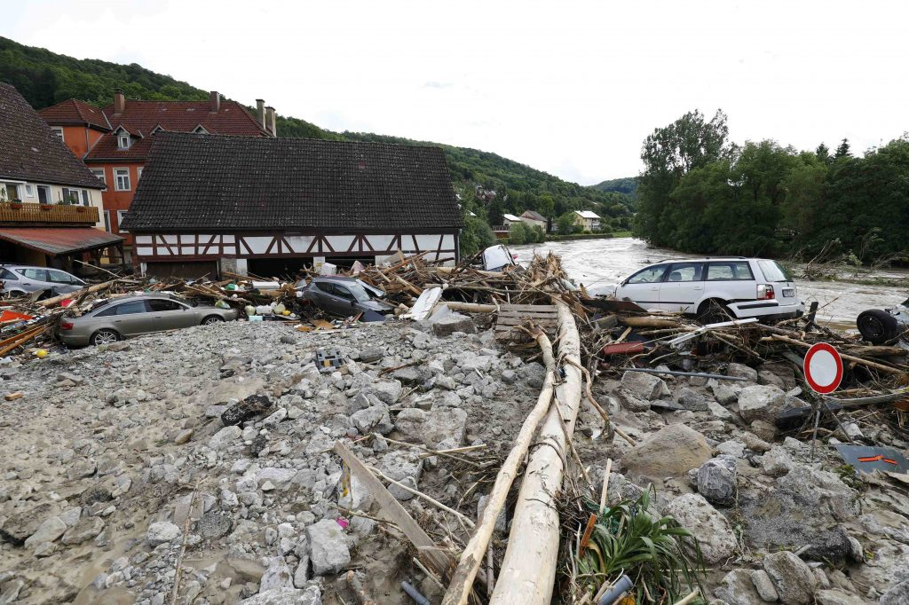 Cars lie amongst debris following floods in the town of Braunsbach, in Baden-Wuerttemberg, Germany, May 30, 2016. REUTERS/Kai Pfaffenbach