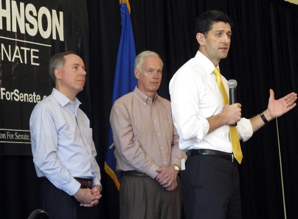 House Speaker Paul Ryan joins Wisconsin state Assembly Speaker Robin Vos, left, and Sen. Ron Johnson, R-Wis., center, at a campaign rally for Johnson on Thursday in Burlington, Wis. (AP Photo Scott Bauer)