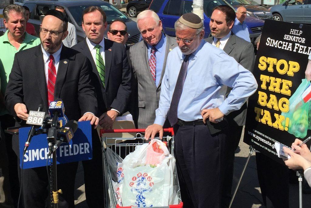 State Sen. Simcha Felder (L) surrounded by other state legislators, at Thursday's press conference. (Yosef Caldwell/Hamodia)