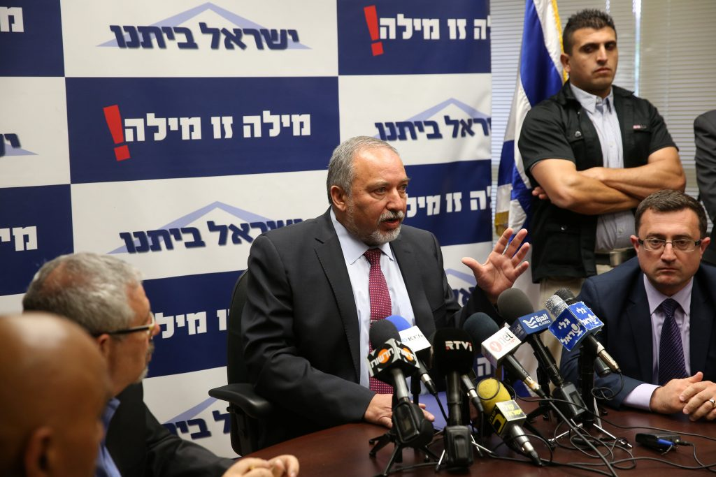 Avigdor Lieberman (C), head of far-right Yisrael Beitenu party, speaks during his party's meeting in the Knesset, the Israeli parliament, in Jerusalem May 23, 2016. REUTERS/Ronen Zvulun