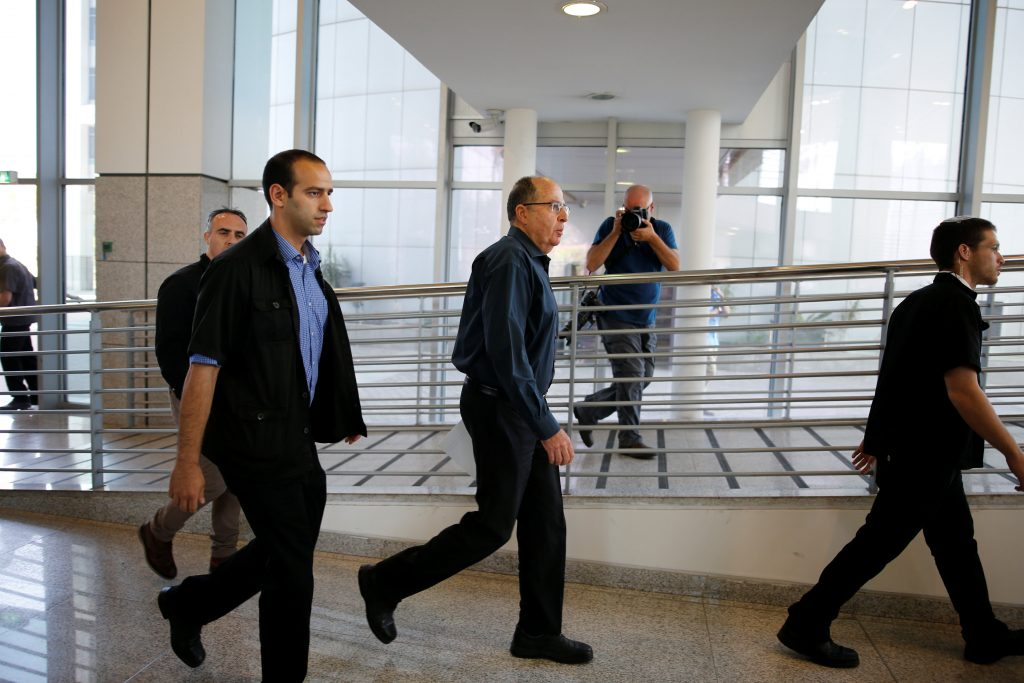 Israel's Defence Minister Moshe Yaalon (C) arrives before giving statement to the press at the Kirya Army base in Tel Aviv, Israel May 20, 2016. REUTERS/Amir Cohen