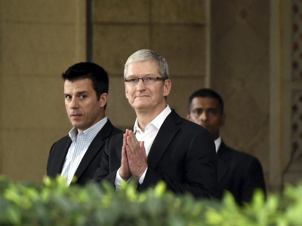 Apple CEO Tim Cook, greets in Indian style at the Taj Mahal hotel in Mumbai, India, on Wednesday. (Press Trust of India via AP)